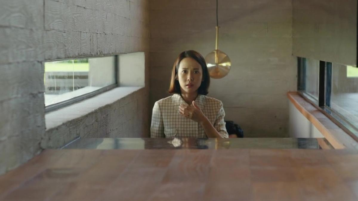 Mrs. Park (Jo Yeo-jeong) has more than one intruder in her home in Bong Joon Ho's Parasite.