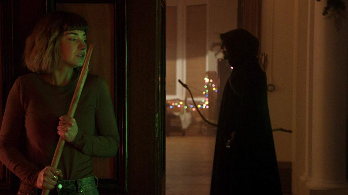 Riley (Imogen Poots, left) battles holiday intruders in Sophia Takal's 'Black Christmas'.