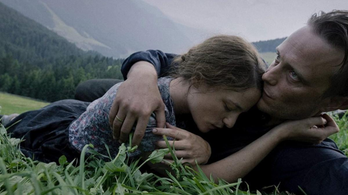 Franz (August Diehl, right) and Fani Jägerstätter (Valerie Pachner) savor everying they could lose in Terrence Malick's 'A Hidden Life'.