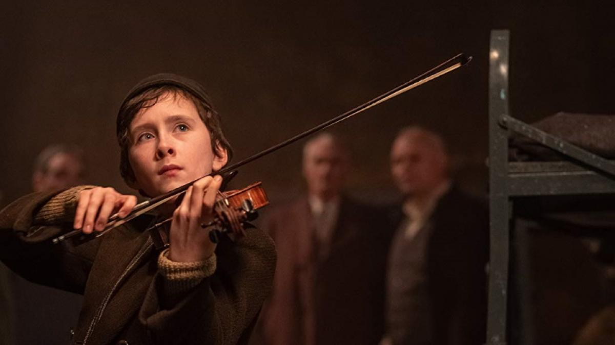 Young Dovidl (Luke Doyle) plays the violin in François Girard's 'The Song of Names'.