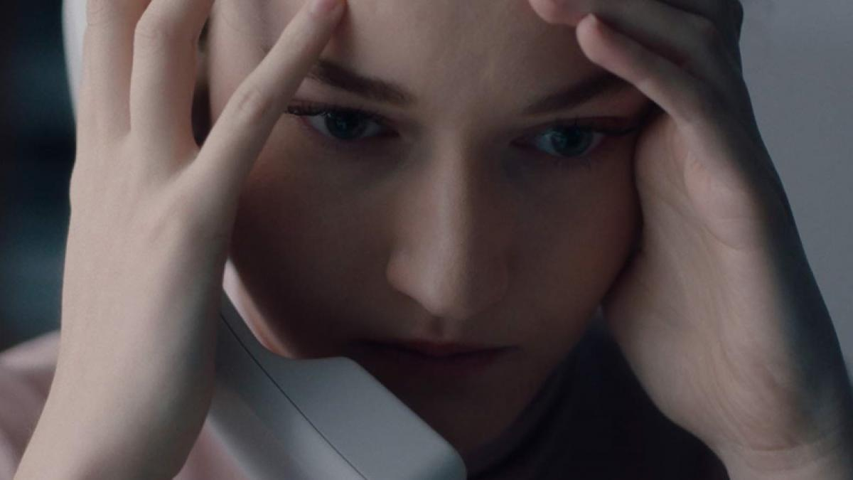 Jane (Julia Garner), head in her heads, navigates a hostile workplace in Kitty Green's 'The Assistant'.