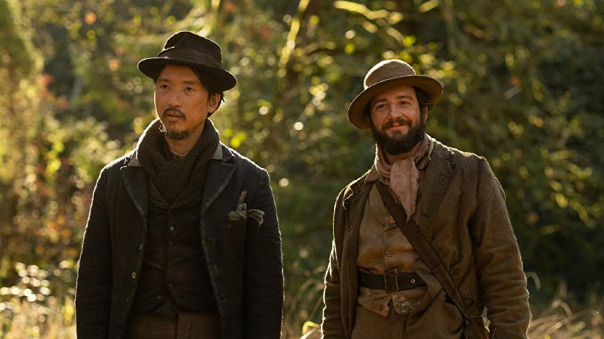 King Lu (Orion Lee, left) and Cookie Figowitz (John Magaro) forge a friendship over biscuits in Kelly Reichardt's 'First Cow'.
