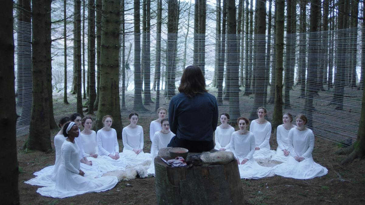 Shepherd (Michiel Huisman) preaches to his flock in Małgorzata Szumowska's 'The Other Lamb'.