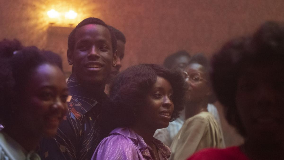 Amarah-Jae St. Aubyn (center front) and Michael Ward (center-left) hit the dance floor in 1980 London in Steve McQueen's 'Lovers Rock'.